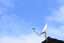 A Satellite Dish On The Roof
