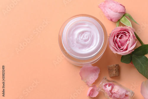 Fotografie, Obraz  Beautiful composition with body cream and flowers on color background