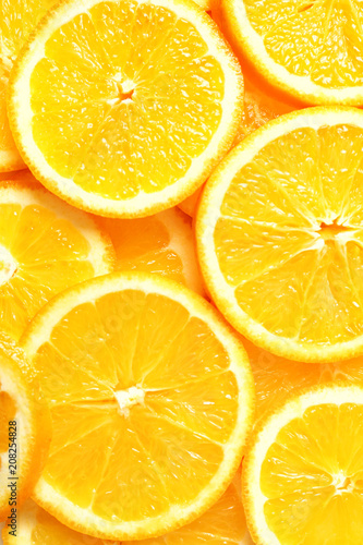 Photo Stands Slices of fruit Sliced ripe citrus fruit as background
