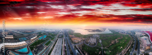 Yas Island, Abu Dhabi. Panoramic aerial view of main landmarks at dusk, United Arab Emirates