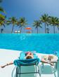 Woman at the swimming pool at the tropical resort