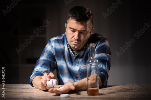 Photo depression, drug abuse and addiction people concept - unhappy drunk man with bot