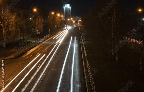 Foto op Plexiglas Nacht snelweg Night city. Light marks on the highway. Blurred motion.