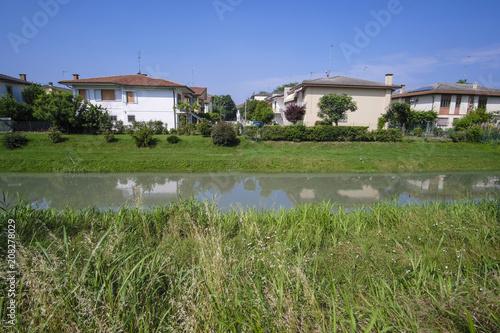Foto op Plexiglas Zuid Afrika Rovigo, Italy - June, 5, 2018: house on the bank of a river in the vicinity of Rovigo, Italy