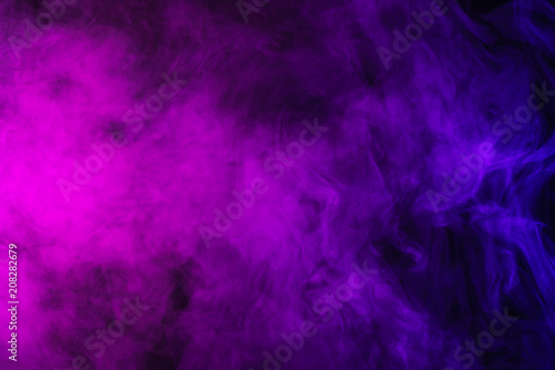 abstract pink and purple smoke on black background