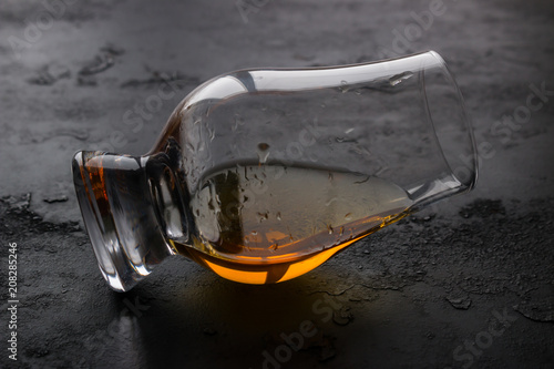 a whiskey glass closeup on a black background Wallpaper Mural