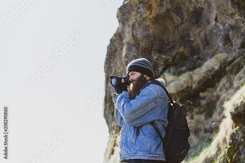 Traveler taking picture from hill