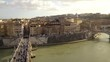 Rome panorama as seen from Castel Sant Angelo. Summer day. Europe Italy. Scenery. Green waters of the Tiber. Cars and other vehicles. Left ot right pan real time medium shot