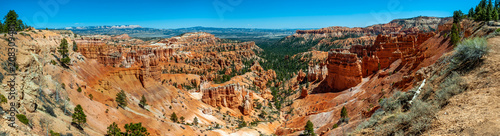 Poster Natural Park Panoramic View of Bryce Canyon National Park From the Rim Trail. A popular trail above Bryce Canyon that connects all the scenic overlooks from Fairyland Point to Bryce Point.