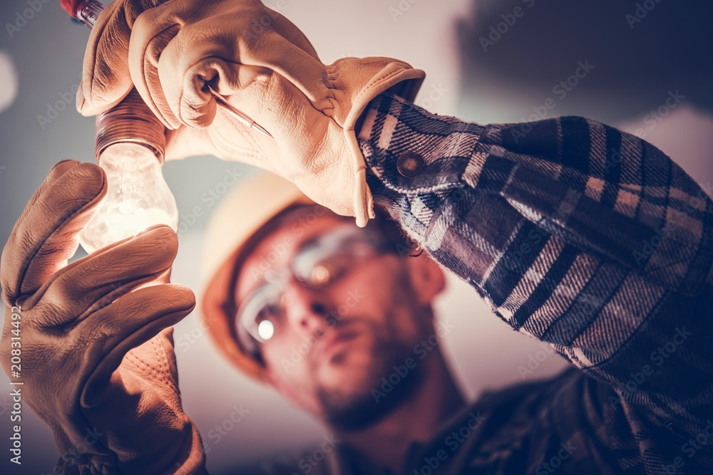 Fototapety, obrazy: Electrician Fixing the Light