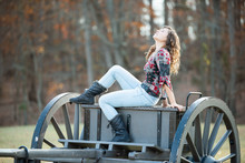 Young Happy Woman Sitting On O...