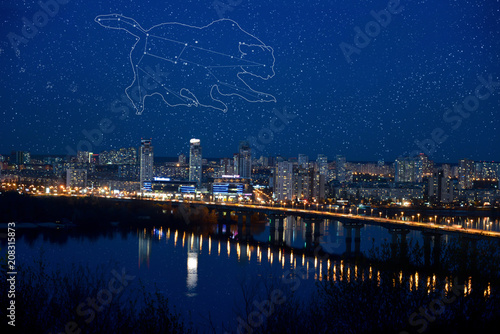 Fotobehang Kiev Ursa Major Constellation. Kyiv. Dnieper River. Ukraine. Ursa Major is walking over night city. The Big Dipper called as the Plough is the part of the Great Bear constellation.