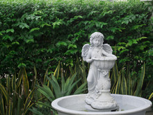 Fairy Statue In The Garden.