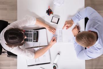 Obraz Two Businesspeople Analyzing Bill