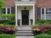 Front Door Of House With Portico Entrance