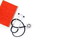Medical Education Concept. Stethoscope On A Textbook Of Medicine On White Background Top View Copy Space