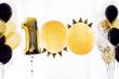 Leinwanddruck Bild - Decoration celebration of 100 one hundred anniversary, white background, gold and black balloons with tassels