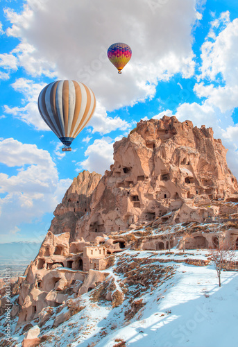 Printed kitchen splashbacks Turkey Hot air balloon flying over rock landscape at Cappadocia Turkey