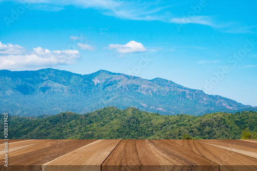 Foto op Aluminium Blauw wooden board empty with blurred landscape reflection background.