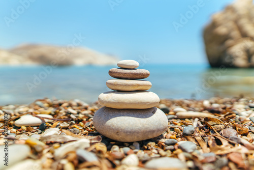 Stack of stones on the beach near sea Wallpaper Mural