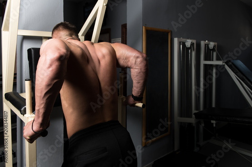 Fototapety, obrazy: Chest And Triceps Exercise on Parallel Bars