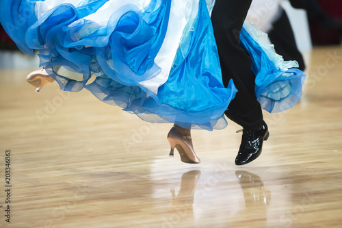 Stampa su Tela Beautiful womanish and masculine legs in active ballroom dance, indoors