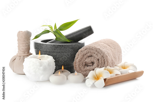 Stampa su Tela Spa composition with mortar, candles and clean towel on white background