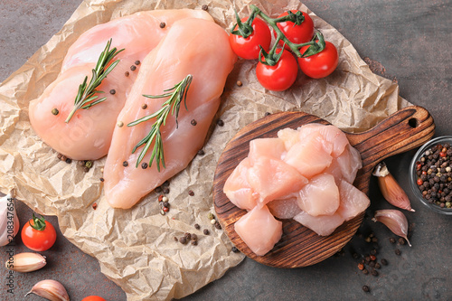 Valokuvatapetti Composition with raw chicken fillet on table