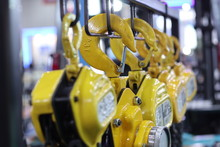 Industrial Steel Chains In Yellow Hoists ; Background