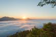 beautiful sunrise over mountain with fog