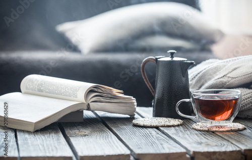 Fototapeta still life book and a cup of tea in the living room obraz