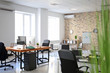 Office interior with tables and armchairs. Workplace design
