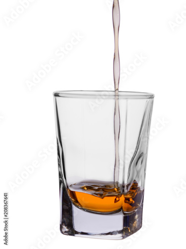 Foto op Plexiglas Alcohol dark stood in a barrel of alcoholic drink poured in a glass