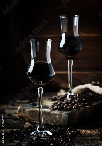 Foto op Plexiglas Milkshake Coffee liqueur, vintage wooden background, selective focus