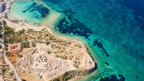 Montage in der Fensternische Blau türkis Aerial drone bird's eye view of iconic temple of Apollo on top of Kolona hill with only one pillar left standing, Aigina island, Saronic gulf, Greece