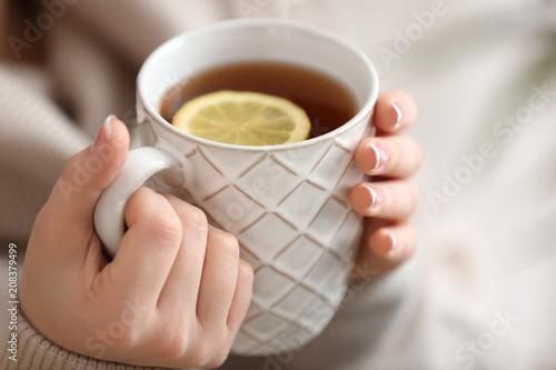 Garden Poster Tea Beautiful young woman with cup of hot tea, closeup