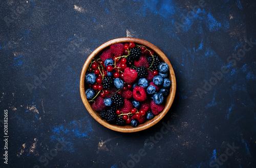 Fototapeta Summer berries in assortment, food background, top view