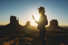 Woman Using Mobile, Monument Valley, Utah, USA