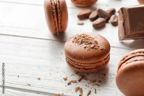 Canvas Prints Macarons Delicious chocolate macarons on wooden background