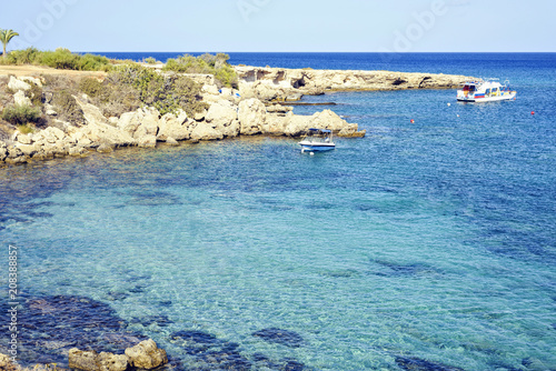 Foto op Canvas Cyprus Daylight view to beach with boats in crystal clear water