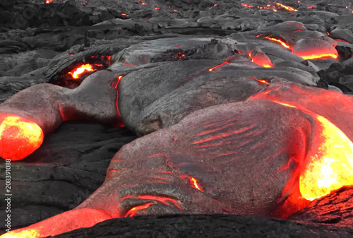 Staande foto Vulkaan Pouring lava on the slope of the volcano. Volcanic eruption and magma
