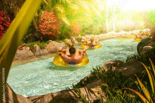 Obraz People floating on lazy river in Siam Park, Tenerife, Spain. - fototapety do salonu