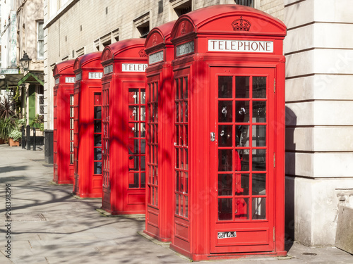 Traditional red cast iron telephone boxes in London Wallpaper Mural