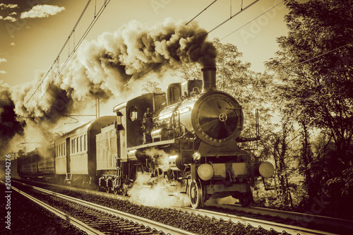Pinturas sobre lienzo  Steam train running on rails, vintage retro film photo filter applied