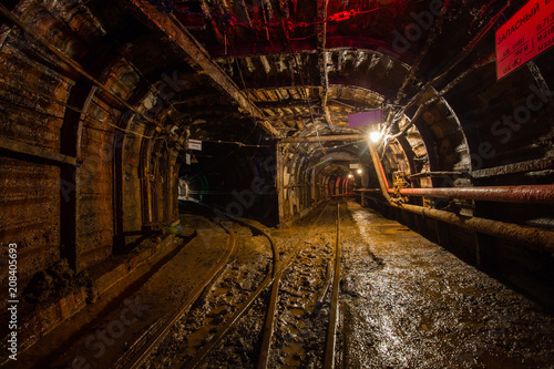 Foto op Canvas Vintage Poster Underground emerald ore mine shaft tunnel gallery with light