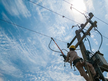 The Power Lineman Closing A Tr...