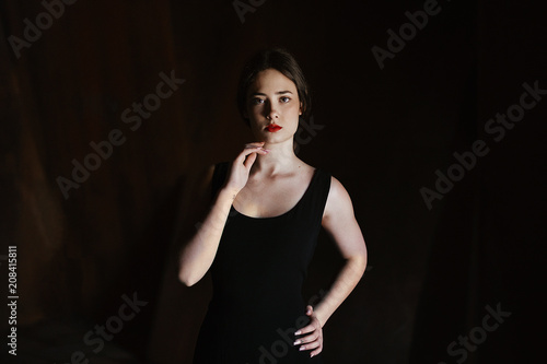 Attractive young woman in black dress