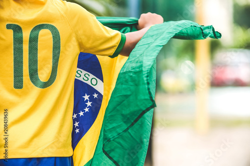 Photo  Brazilian Boy Holding The Flag of Brazil
