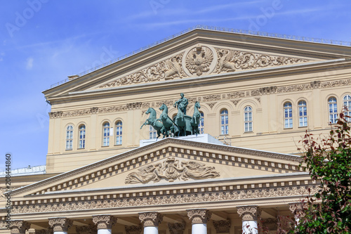 Foto op Plexiglas Theater Facade of Bolshoi Theatre on a blue sky background on a sunny summer morning
