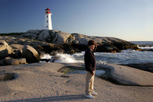 Man Views The Sea At Peggys Cove
